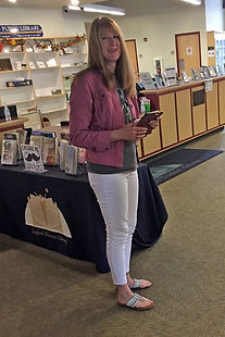 The author of Anatomy of a Ghost at a book signing at the Seaford Library