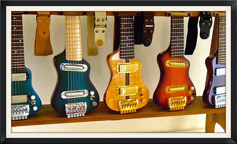 small electric guitars for travel and practice. Smallest travel guitar