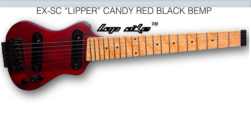 Travel guitar by Lap axe with birdseye maple fretboard.