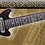 Black travel guitar with chrome single coil pickups