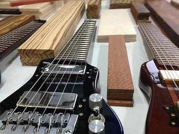 Custom travel electric guitar prepared for sale