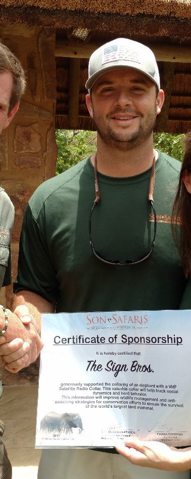 Our team members being gifted a certificate from Son Safaris and Welgevonden for helping fund a GPS radio collar for the elephants