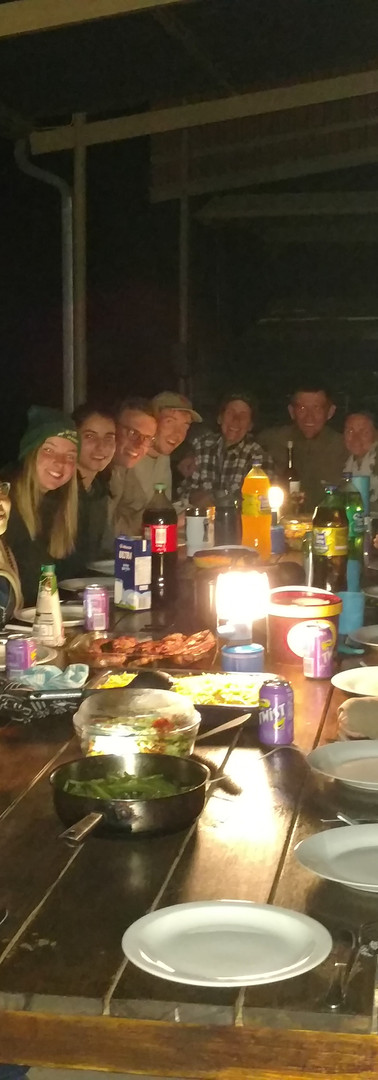 Our team sharing the dinner table with the research camp staff