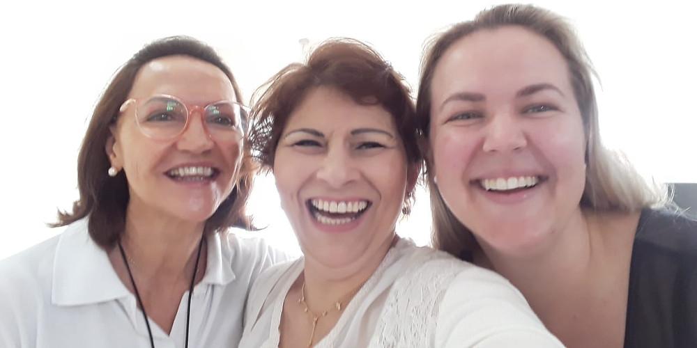 Com a professora da Feevale Márcia Alexandre e a colega quiropraxista Anne Nicole