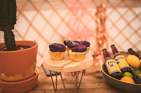 Cupcakes on cake stand in yurt