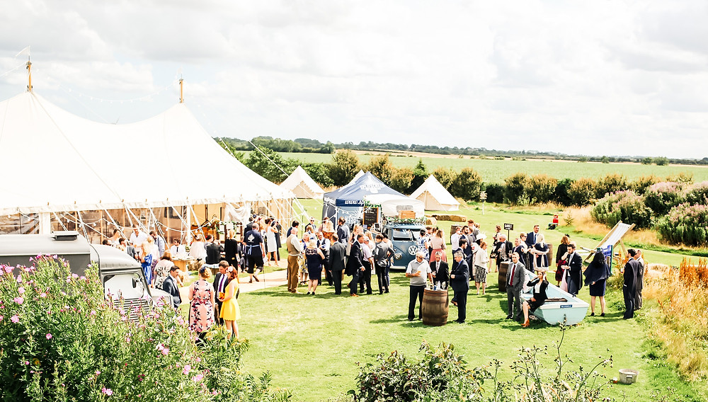 Outdoor marquee wedding with bell tents