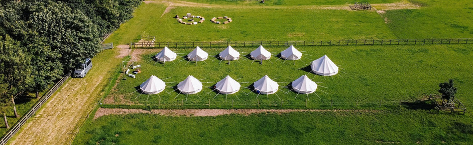 Aerial  shot of bell tent village for wedding accomodation