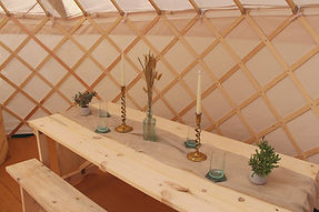 Reclaimed 6ft table with benches in yurt