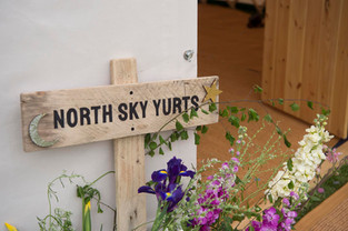 Wooden sign outside yurt in Yorkshire