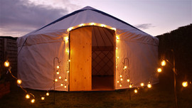 18ft yurt for hire in Leeds, Yorkshire with festoon lights.
