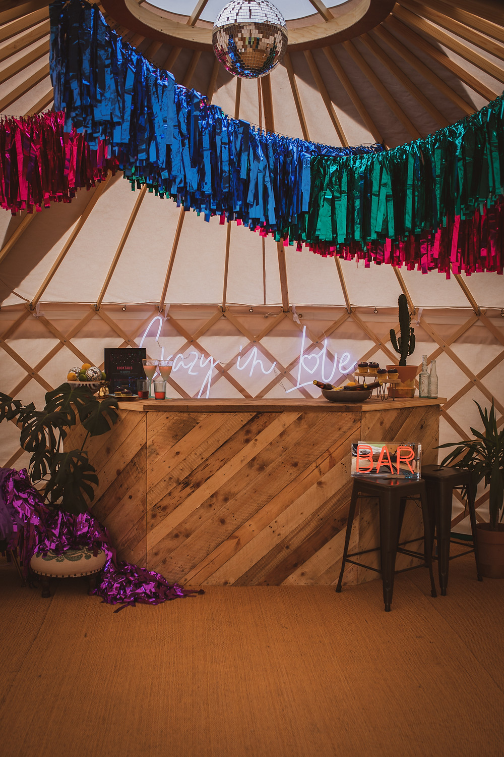 Streamers and disco ball in yurt with yurt bar