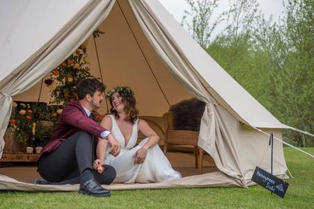 Wedding couple in honeymoon bell tent