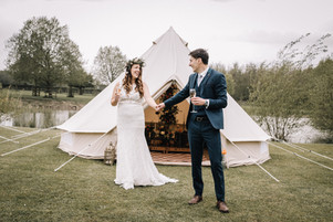 Wedding couple outside bell tent in yorkshire
