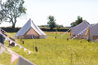 Bell tent village with bunting outside