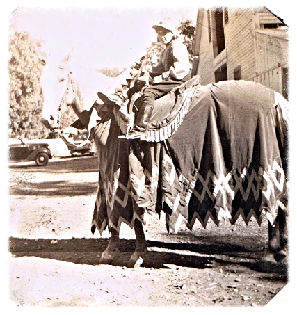 Jewell on Olivia DeHaviland's horse in Bidwell Park filming of Robin Hood