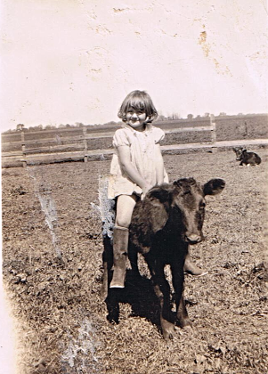 Jewell riding her heifer