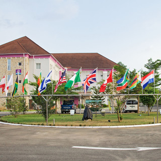 oxygen hotel owerri, outside view with flags