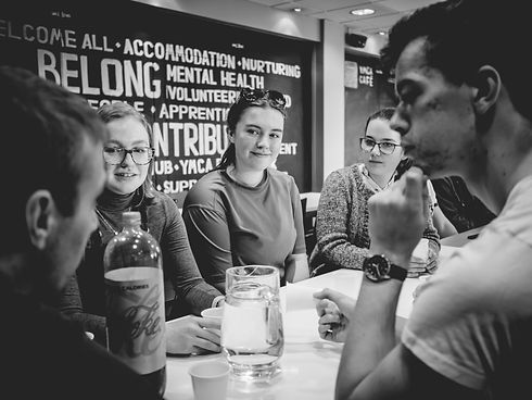 Students gathering at a table image