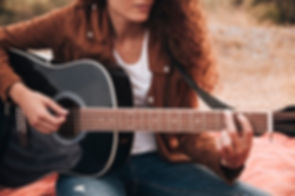 front-view-woman-playing-guitar_23-21482