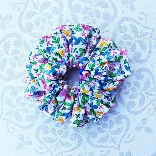 Coletero, foulchie, cinta cruzada prado florido color azul parma