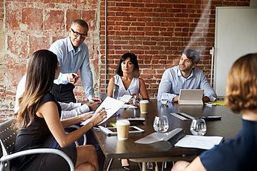 Businesspeople Meeting In Modern Boardro