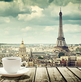 background with cup of coffee and Eiffel