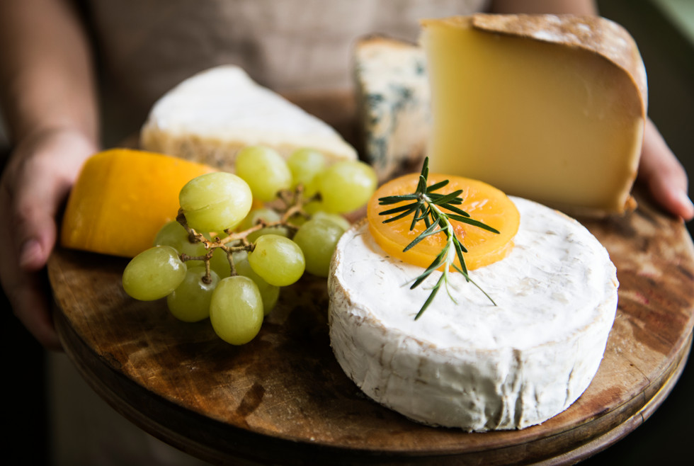 Variation of cheese and green grapes on