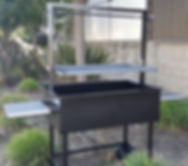Free standing height adjustable Santa Maria BBQ Grill Pit, This wood burning BBQ grill allows for multiple heat zones allowing you to cook the perfect meat each time.