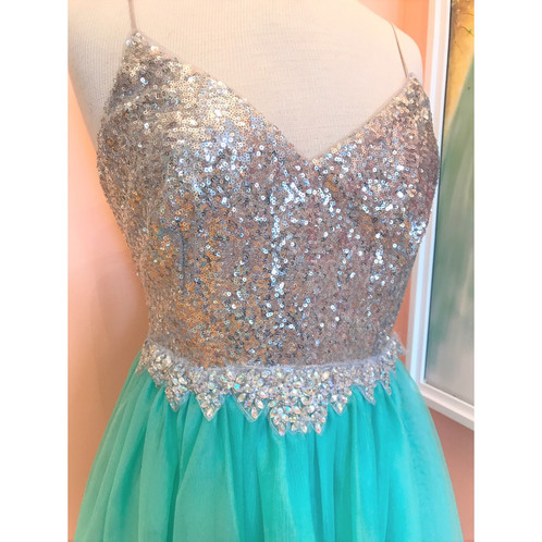 18e5e8836 Aqua tulle skirt is accented by silver sequin bodice and crystal detail at  the waist. Adjustable spaghetti straps. New from the manufacturer with an  ...
