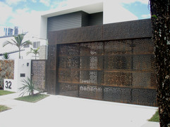 Entry gate and carport in rust finish