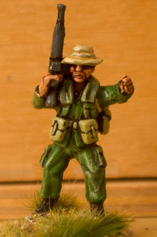 VAI 13 Kit Carson Scout, pointing, wearing bush hat, with M16