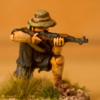VVC 108 Infantryman, kneeling, wearing jungle hat, firing SKS rifle