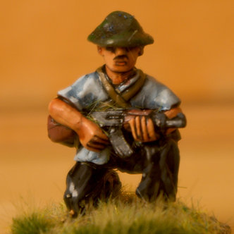 VVC 110 Infantryman, kneeling, wearing jungle hat, holding AK 47