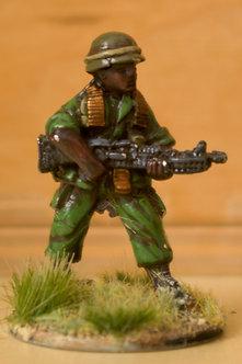 VAI 6 Infantryman, standing,  wearing helmet, firing M60