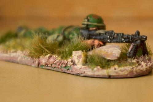 VAI 11 Infantryman, prone, wearing flak jacket, firing M60