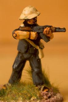 VVC 102 Infantryman, standing, wearing jungle hat, firing AK 47