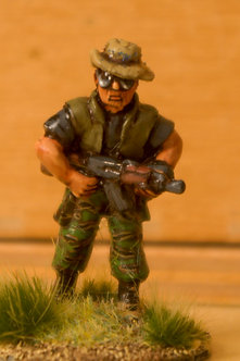 VAI 14 Kit Carson Scout, advancing, wearing bush hat and flak jacket, , with AK