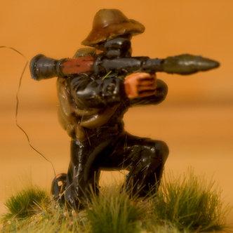 VVC 112 Infantryman, kneeling, wearing jungle hat, firing RPG