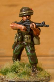 VAI 3 Infantryman, standing,  wearing helmet,firing M16