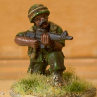VAI 2 Infantryman, kneeling,  wearing helmet,firing M16