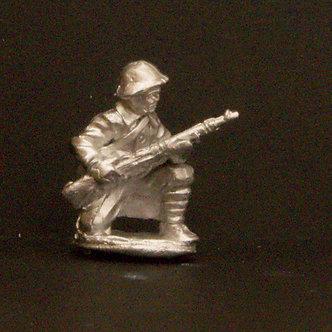 WWR 56   Infantryman, kneeling holding rifle, wearing helmet and greatcoat