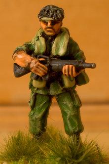 VAI 18 Platoon Sergeant standing, bareheaded, holding M16
