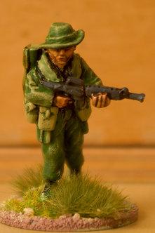 VAI 19 Infantryman, advancing,  wearing bush hat, holding M16, carrying LAW