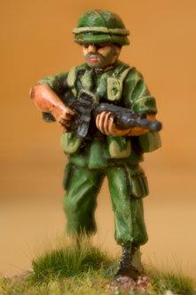 VAI 9 Infantryman, standing,  wearing helmet, holding M16