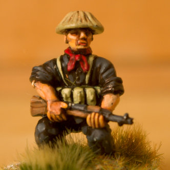 VVC 101 Infantryman crouching, wearing covered hat, holding SKS rifle