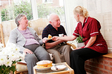 Home-Care-Worker-and-Elderly-Couple.jpg