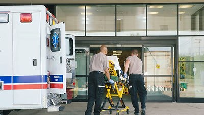 paramedics-taking-patient-on-stretcher-f