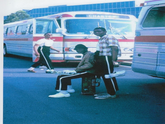 Cornel, Dalton, Merv near buses at show