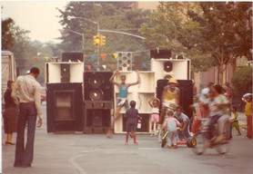 Young Lady Dancing In Front Of Speakers