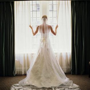 Bride looks ot the window at Unversity Club Chicago